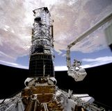 Astronauts repairing Hubble Stock Images