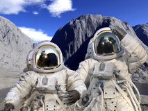 Astronauts on a rocky landscape Royalty Free Stock Photography