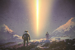 Astronauts walking to mystery light beam from the sky. Sci-fi concept, illustration painting Royalty Free Stock Photos