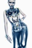 Astronautyczna kobieta w srebnym kostiumu w świetle Zdjęcie Stock