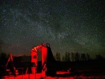 Astronomer and Milky way stars on night sky Stock Image