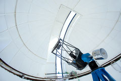 Astronomic observatory telescope in a dome. Astronomic observatory telescope inside a white dome Royalty Free Stock Image