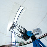 Astronomic observatory telescope in a dome. Astronomic observatory telescope inside a white dome Royalty Free Stock Photography
