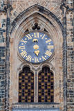 Astronomical Clock and gate of the Gothic Cathedral of Saints Vitus, Prague Castle, Czech Republic Europe. Stock Image