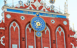 Astronomical clock on the House of Blackheads, Riga, Latvia. Stock Photos
