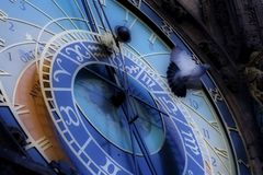 Astronomical clock in Prague. Close view of astronomical clock in Prague with a pigeon flying Royalty Free Stock Photo