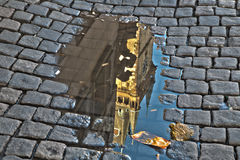 Astronomical clock in Prague in puddle Stock Photography