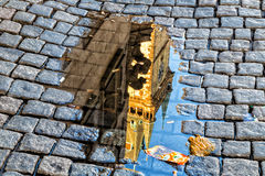 Astronomical clock in Prague in puddle Royalty Free Stock Photos