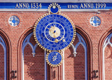 Astronomical clock in Riga, Latvia. The inscription on the build. Ing: built in 1334 restored in 1999 royalty free stock photography
