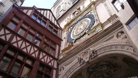 Astronomical clock in Rouen, Normandy France, PAN. Exterior of an astronomical clock called the Gros Horloge in Rouen, Normandy France. Panning shot stock video footage