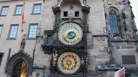 Astronomical clock striking hour on old town hall of Prague stock video footage