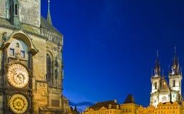 Astronomical Clock & Tyn Church. Twilight on the Astronomical Clock & Tyn Church in Prague Stock Photo