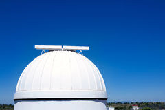 Astronomical observatory dome in blue sky Royalty Free Stock Photo