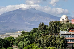 Astronomical observatory. The dome of the astronomical observatory at the University of Catania. Mount Etna in the background Royalty Free Stock Image