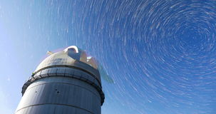 Astronomical Observatory under the night sky stars. 4k timelapse in comet mode. Rozhen astronomical observatory under the night sky stars. Blue sky with hundreds stock footage