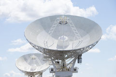 Astronomical telescope dishes at blue sky Stock Photos