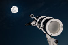 Astronomical telescope over dark sky with the moon Royalty Free Stock Photos
