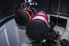 Astronomical Telescope Setup in an Observatory. Permanent installation of telescopes in an astronomical dome for exploration of the cosmos royalty free stock images