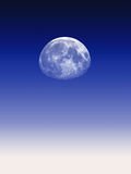 Astronomy. Moon over graduated deep blue sky background Stock Photo