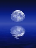 Astronomy. Moon reflected in lake, over graduated deep blue sky background Royalty Free Stock Photography