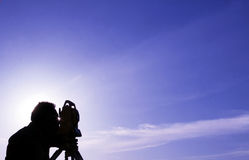 Astronomy. An astrologer scanning the sky stock images