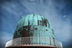 Astronomy observatory science dome. Observatory for the science of astronomy at herstmonceux in england. Dome building for star telescope against blue sky royalty free stock photos