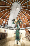Astronomy telescope in an astronomical observatory. Historical astronomy telescope in an astronomical observatory Royalty Free Stock Image