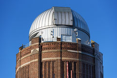 Astronomy tower. Lund, Sweden - January 21, 2016: The top part of the southern astronomy observation tower in Lund against a blue sky. The metal dome sits on top Stock Photo