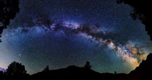 Astrophotography of Milky Way galaxy. Panoramic astrophotography of whole visible Milky Way galaxy. Silhouette of mountains. Stars, nebula and stardust at night royalty free stock image