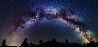 Astrophotography of Milky Way galaxy. Panoramic astrophotography of whole visible Milky Way galaxy. Silhouette of mountains. Stars, nebula and stardust at night royalty free stock photography