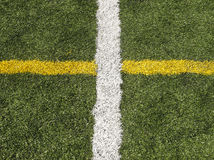 Astroturf Sports Field. Astroturf soccer field with white and yellow markings Royalty Free Stock Photography
