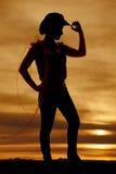Astuce de prise de silhouette de cow-girl de chapeau avec la corde Photos stock