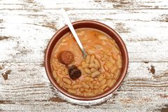 Asturian bean stew in a clay pot. Stock Image