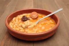 Asturian bean stew in a clay pot. stock photo