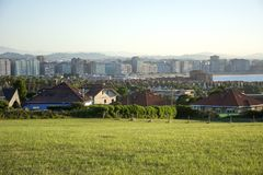 Asturian landscape 95. Photo of a landscape with blue sky, several buildings and sunlight Royalty Free Stock Photo