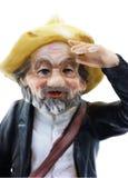 Astute old man figurine. A shrewd elderly gentleman with a keen eye royalty free stock photography