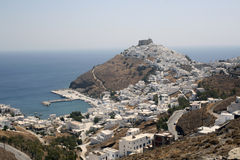 Astypalea Island - Greece. White houses outside the walls of the venetian castle and the Harbor of Pera Yalos - Dodecanese Islands - Greece Royalty Free Stock Image