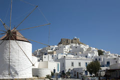 Astypalea - Panoramic view of Chora. Windmill in historic village and Querini Castle at the top of Chora - Dodecanese Islands  Greece Royalty Free Stock Image