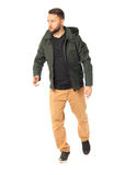 Сasual boy in jacket posing and looking at the camera Stock Photography