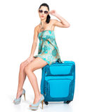 Сasual woman standing with travel suitcase Royalty Free Stock Image