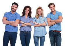 Asual young people standing with hands crossed and smile Stock Photos