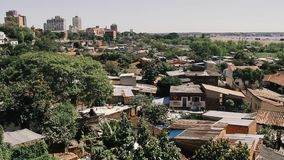 Asuncion, capital of Paraguay. Asuncion is the capital and largest city of Paraguay. The city is located on the left bank of the Paraguay River, almost at the stock video footage