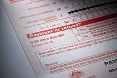 Asunto del reembolso del pago de impuestos Fotos de archivo