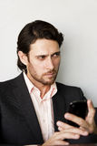 Asunto joven con el teléfono móvil Foto de archivo libre de regalías