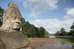 Asura. Head of Asura from the entrance of Angkor Thom Royalty Free Stock Image