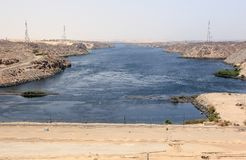 Aswan Dam. The High Dam. Aswan, Egypt. The Aswan Dam is an embankment dam situated across the Nile River in Aswan, Egypt. Since the 1960s, the name commonly Royalty Free Stock Images