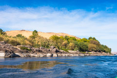 Aswan, Egypt. Beautiful nature of the coastline of the Nile river called First Cataract, Aswan, Egypt royalty free stock photo