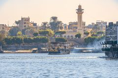 12.11.2018 Aswan, Egypt, a huge cruise ferry moving along a nile against the background of a city. On a sunny day royalty free stock images