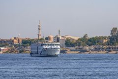 12.11.2018 Aswan, Egypt, a huge cruise ferry moving along a nile against the background of a city. On a sunny day stock photo
