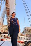 Egyptian woman on Sailboat in the Nile river Stock Photography